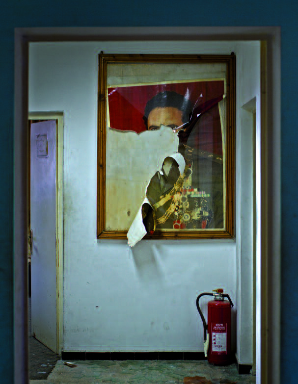 A ripped poster of Muammar Gaddafi hanging in the offices of Abuzed Omar Dorda, the former head of the Libyan intelligence services, in 2011 in Tripoli.